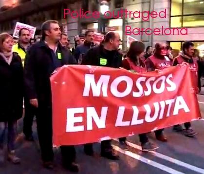 Catalan police as protesters inside demo in Barcelona!